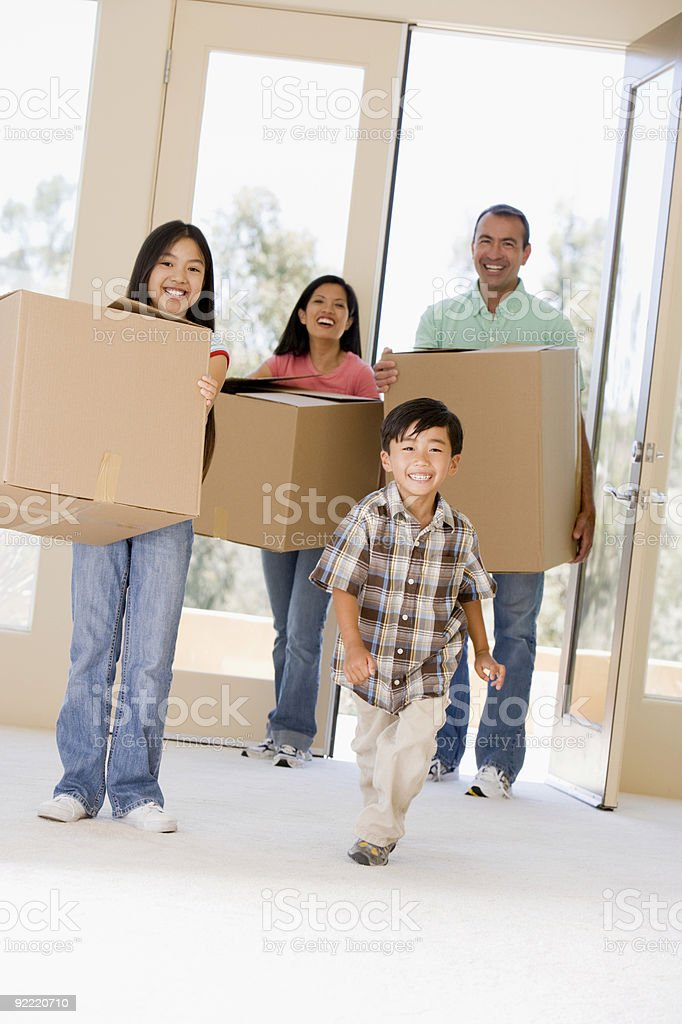 Family moving into new home smiling royalty-free stock photo