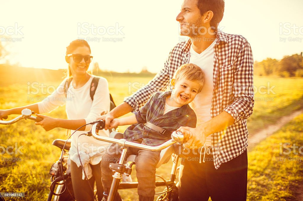 Family of bike lovers stock photo