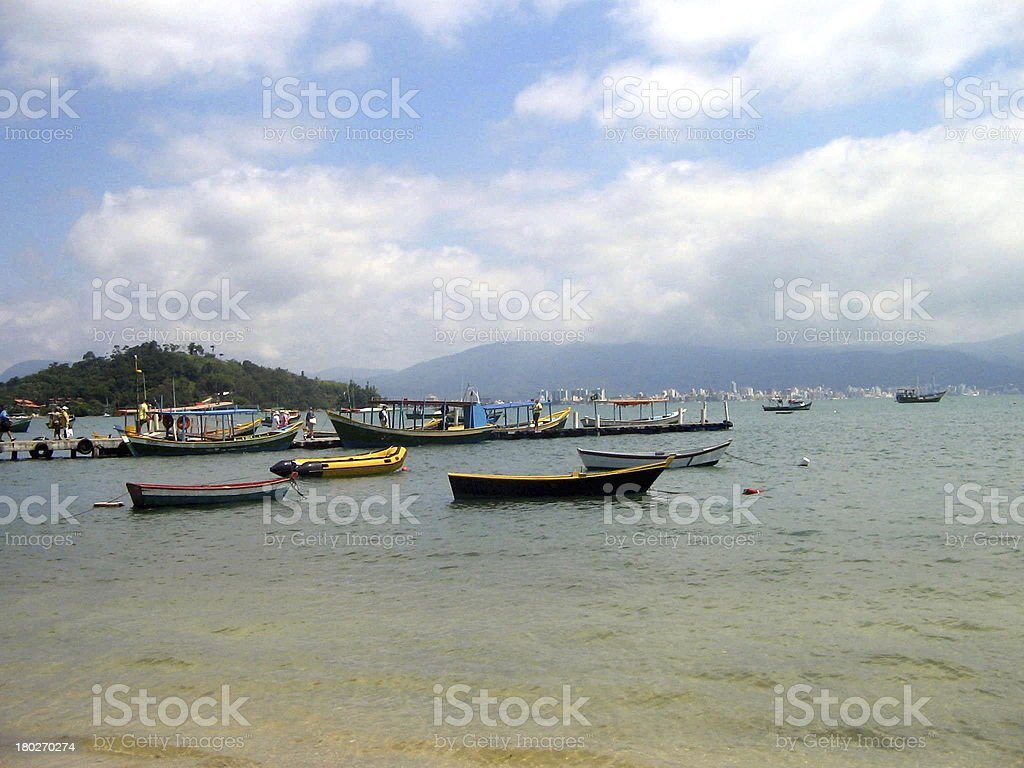 Family of fisherboats in brazilian beach royalty-free stock photo