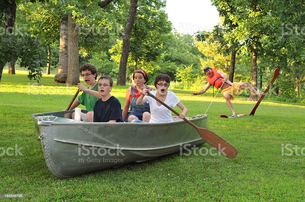 Family of Five Acting Silly Together in the Outdoors stock photo