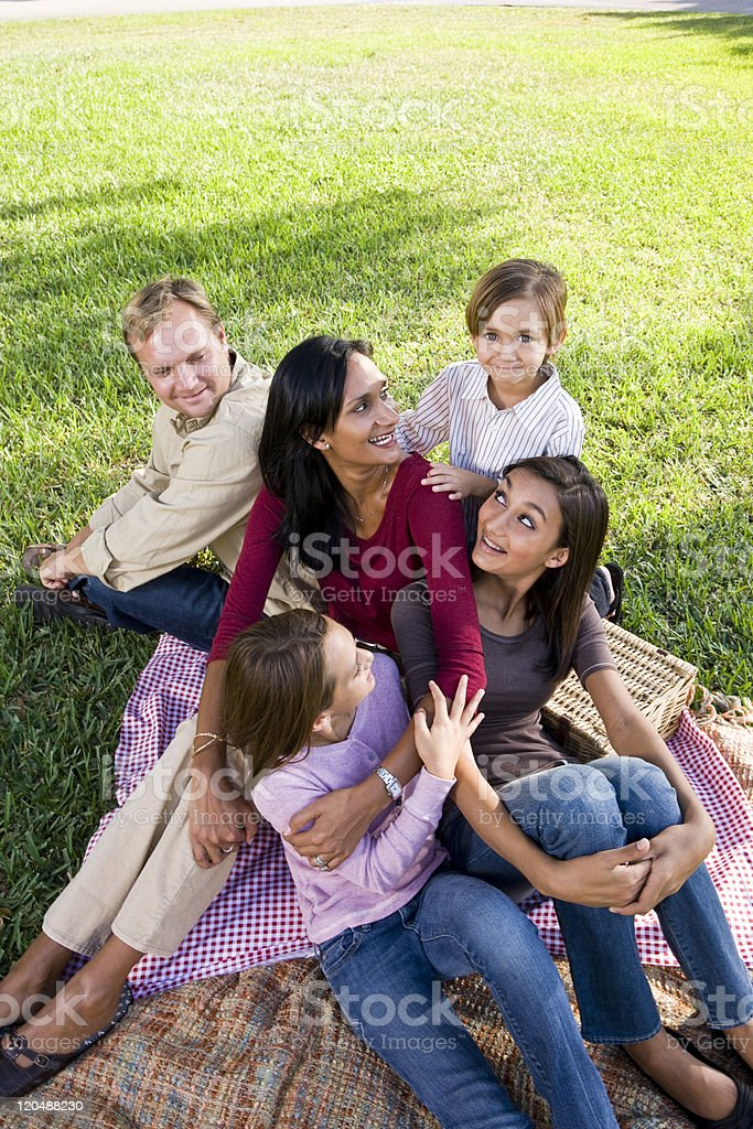 Family of five having picnic in park royalty-free stock photo