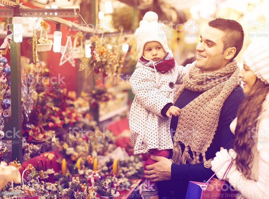 Family of four at Christmas market stock photo
