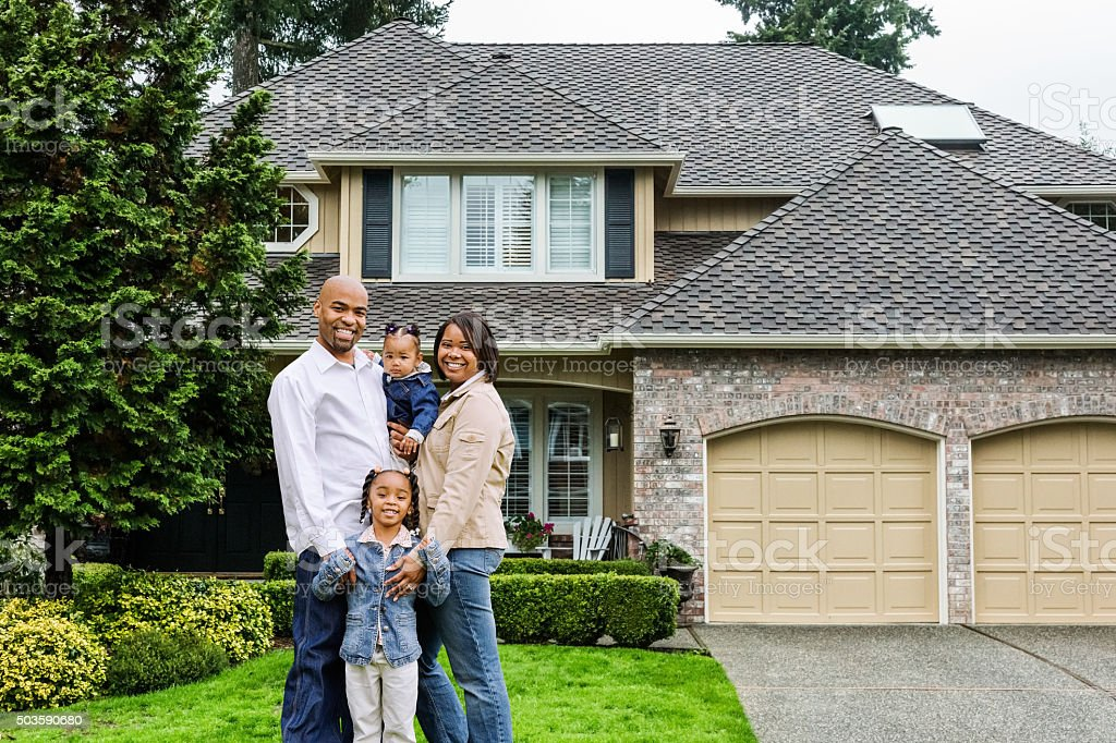 Family of Four at Home in Front Yard stock photo