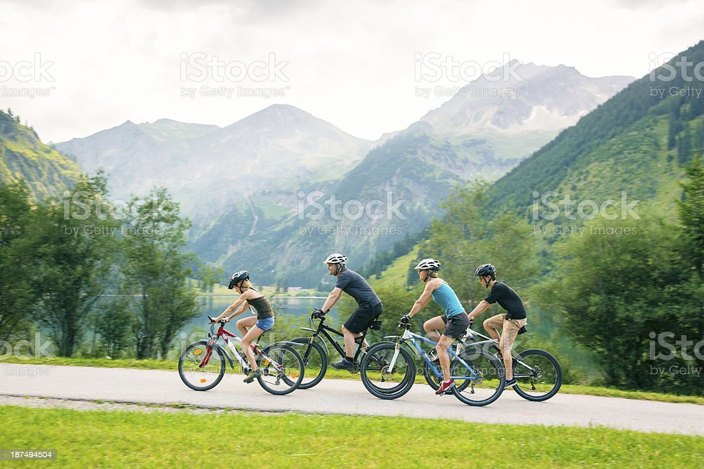 family of four cycling royalty-free stock photo