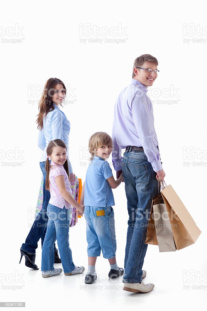 A family of four goes shopping royalty-free stock photo
