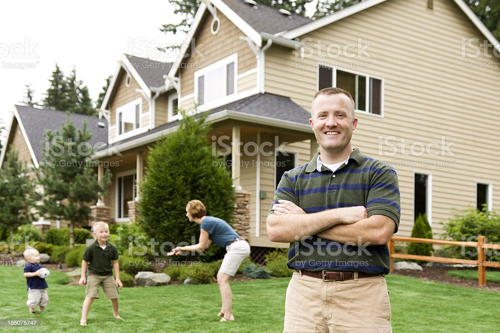 Family of four home with happy proud Dad royalty-free stock photo