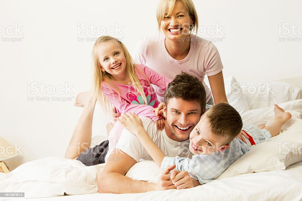 Family Of Four In Bed royalty-free stock photo