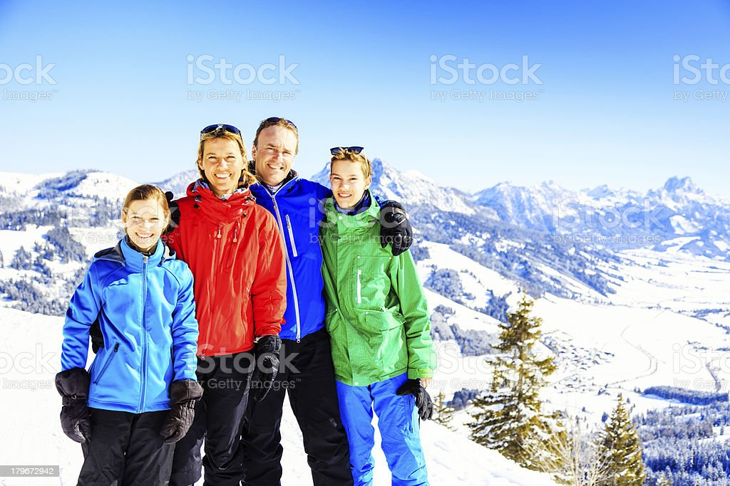 family of four in the austrian alps royalty-free stock photo