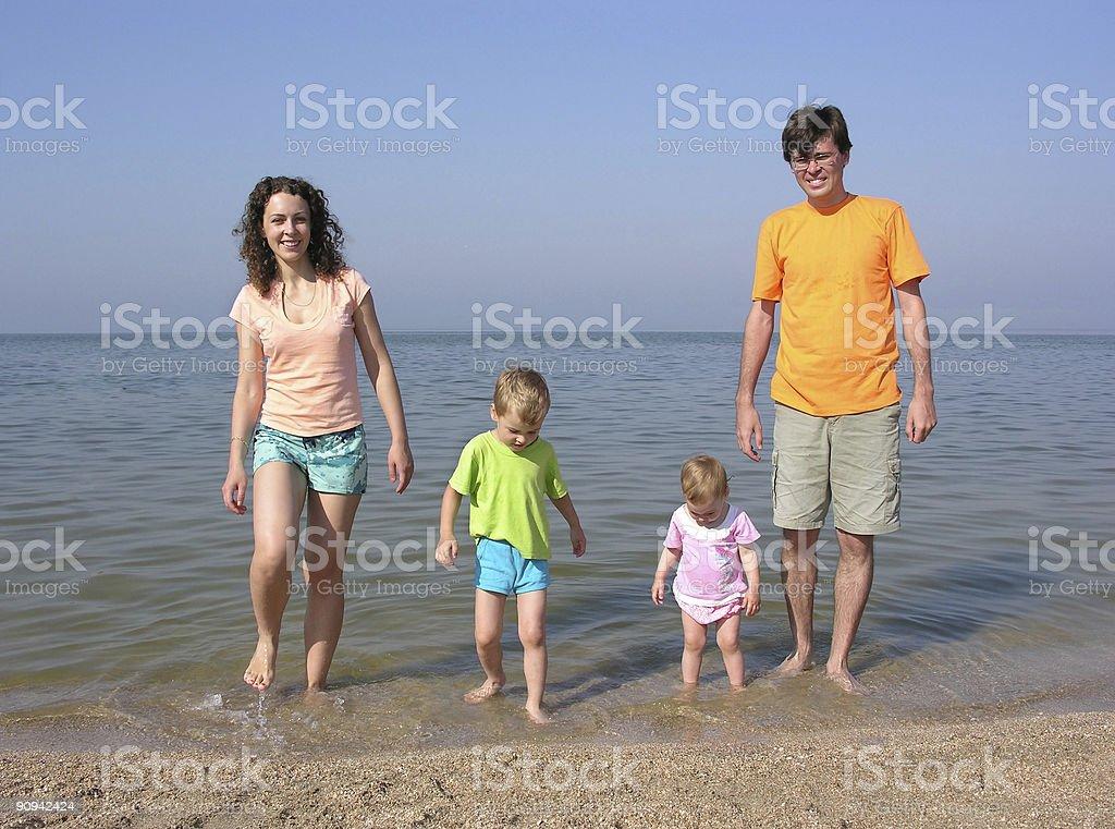 family of four on beach royalty-free stock photo