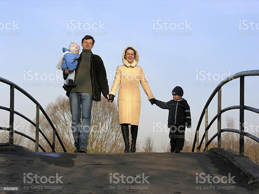family of four on bridge royalty-free stock photo