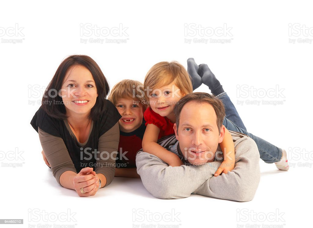 family of four on floor royalty-free stock photo