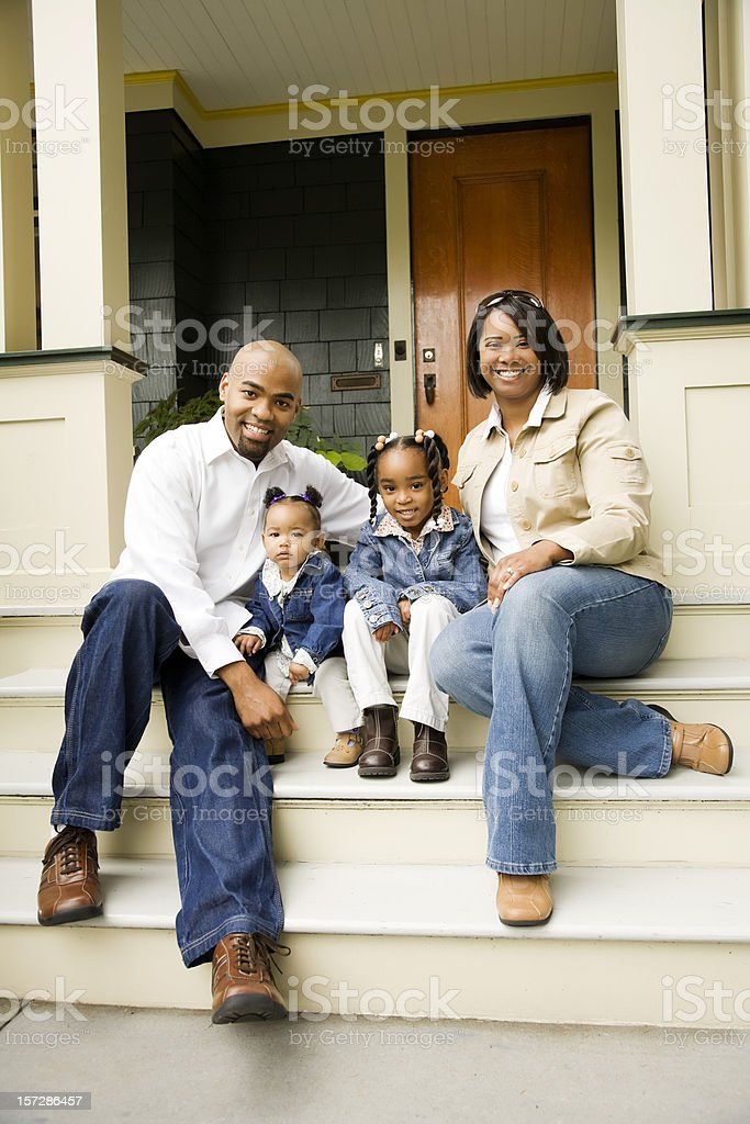 Family of Four on Porch royalty-free stock photo