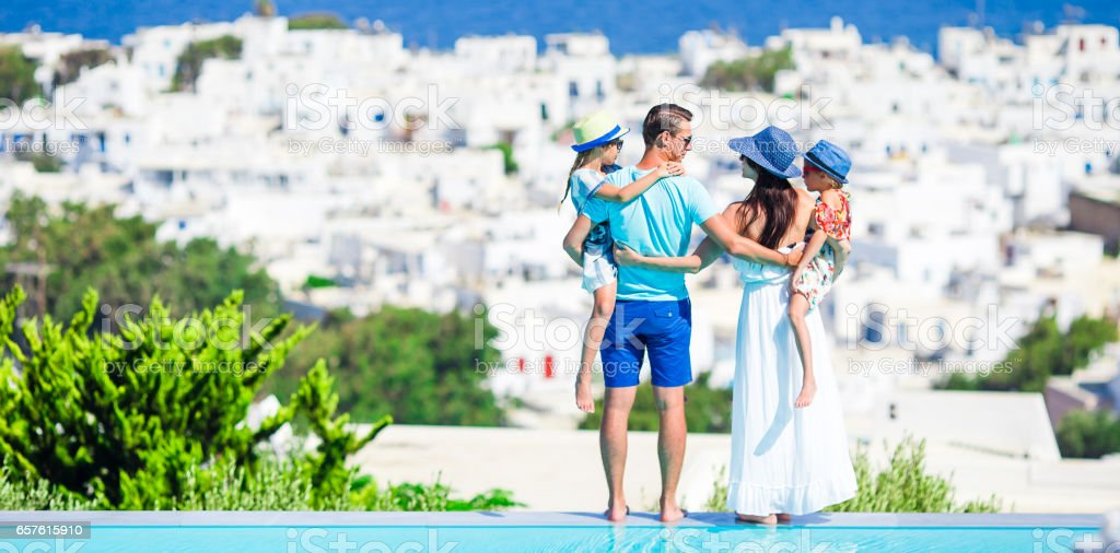 Family of four on vacation with beautiful view on village stock photo