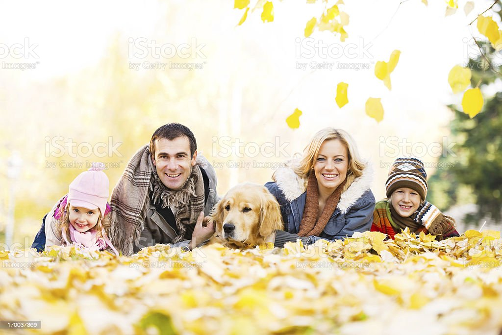 Family of four people with their dog in park. royalty-free stock photo