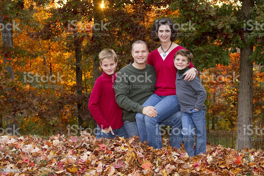 Family Of Four (4) Portrait In Fall /Autumn Leaf Pile royalty-free stock photo