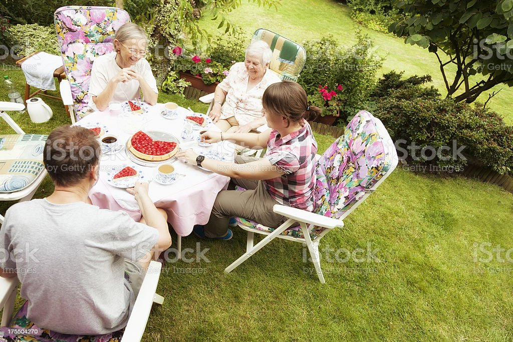 family of four sitting in garden royalty-free stock photo