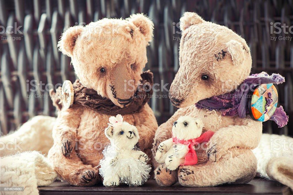 Family of four vintage handmade textile art teddy bear toys stock photo