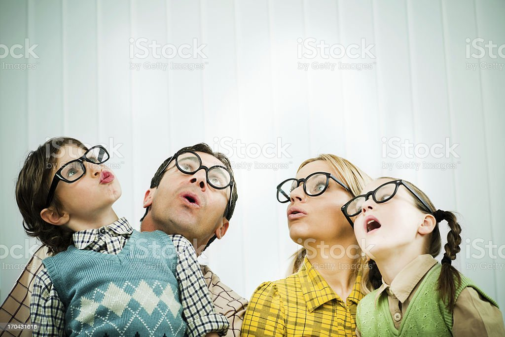 Family of nerds looking up with wonder. stock photo