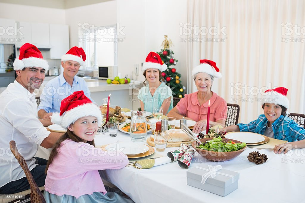 Family of six sitting at dining table royalty-free stock photo