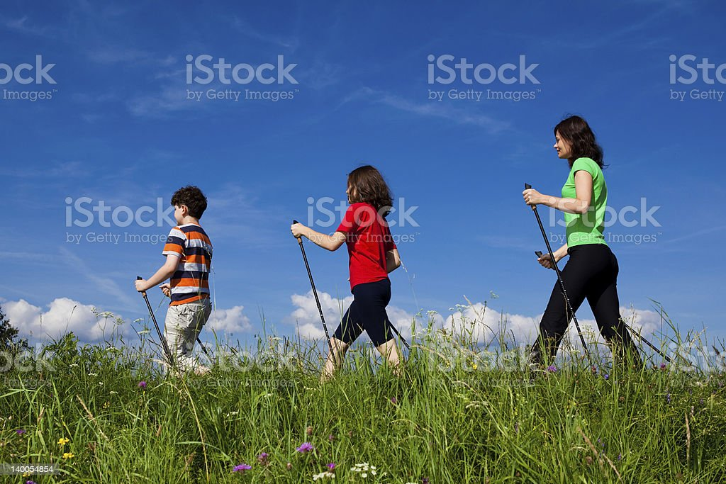 Family of three having a walk on a sunny day stock photo