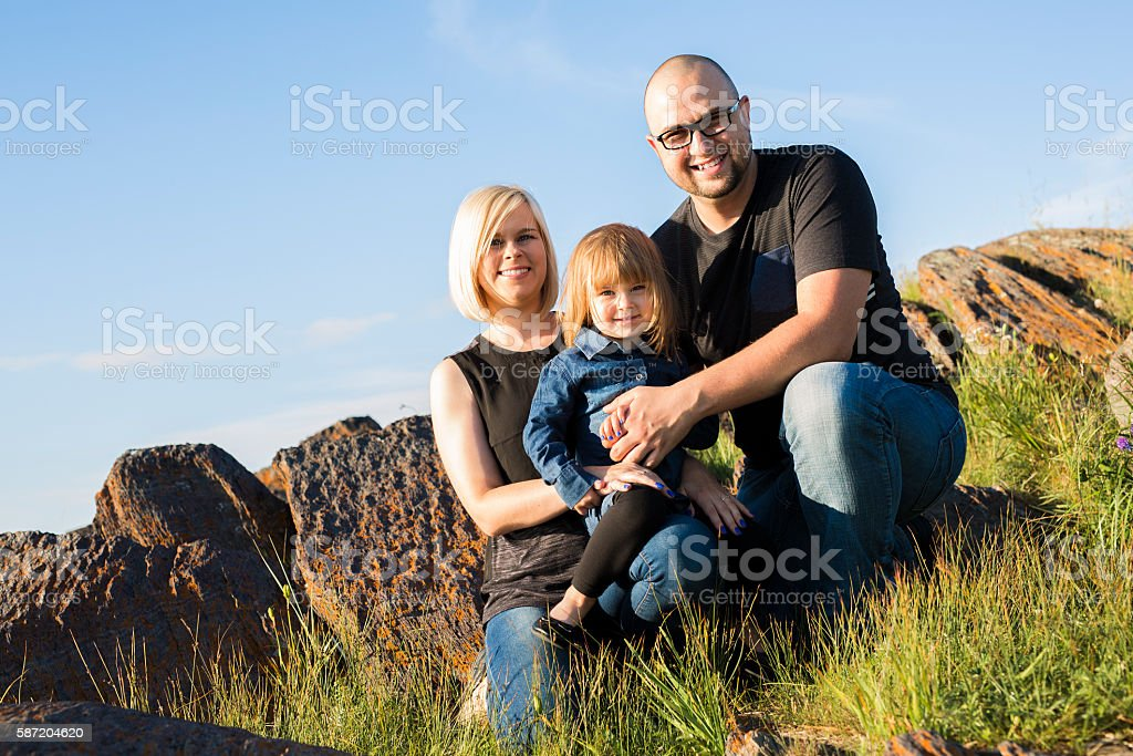 Family of three having fun together stock photo