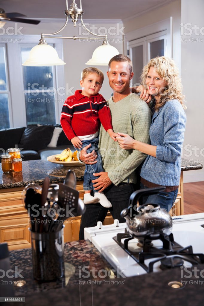 Family of three in kitchen stock photo
