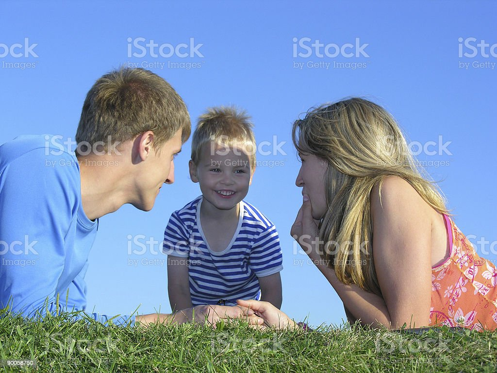 family of three on grass royalty-free stock photo