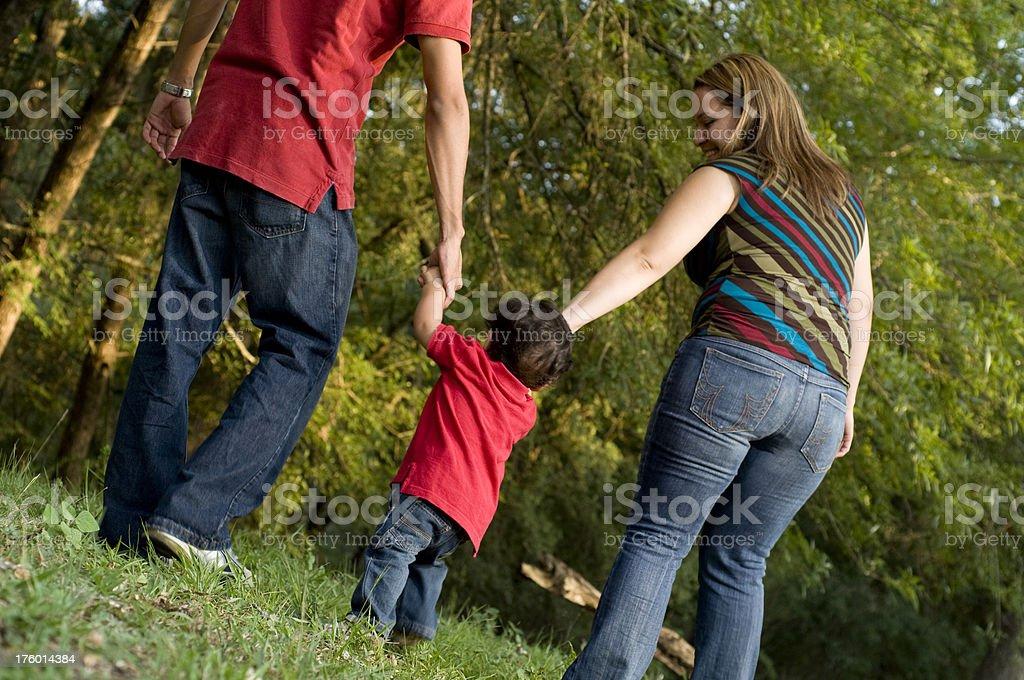 family of three outdoors royalty-free stock photo