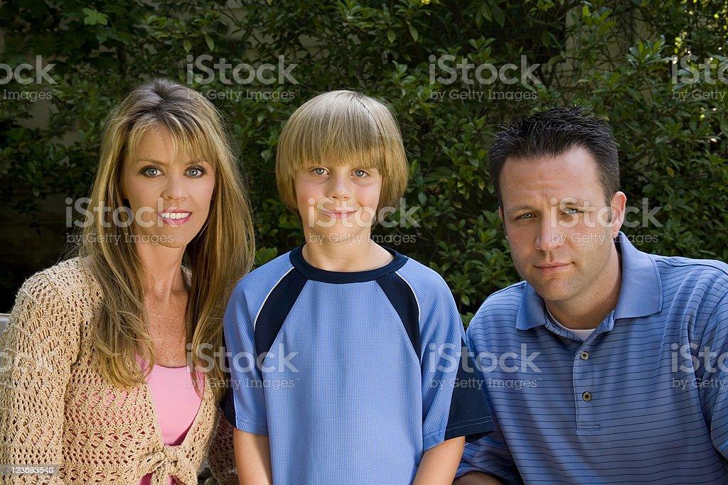 Family of three outside royalty-free stock photo