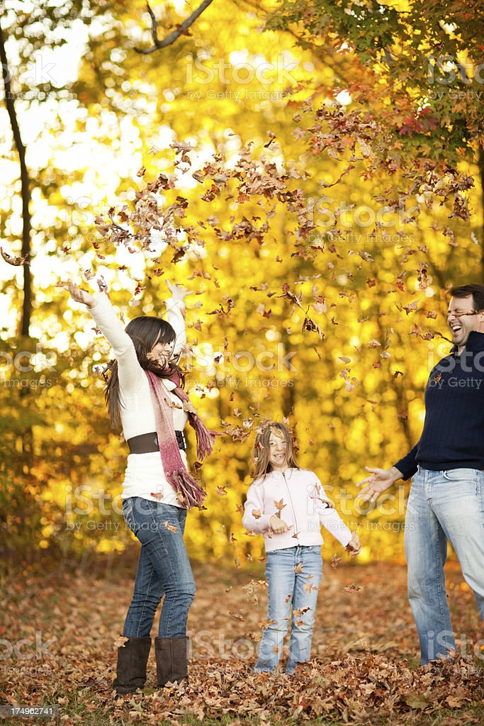 Family of Three Playing in the Autumn Woods royalty-free stock photo