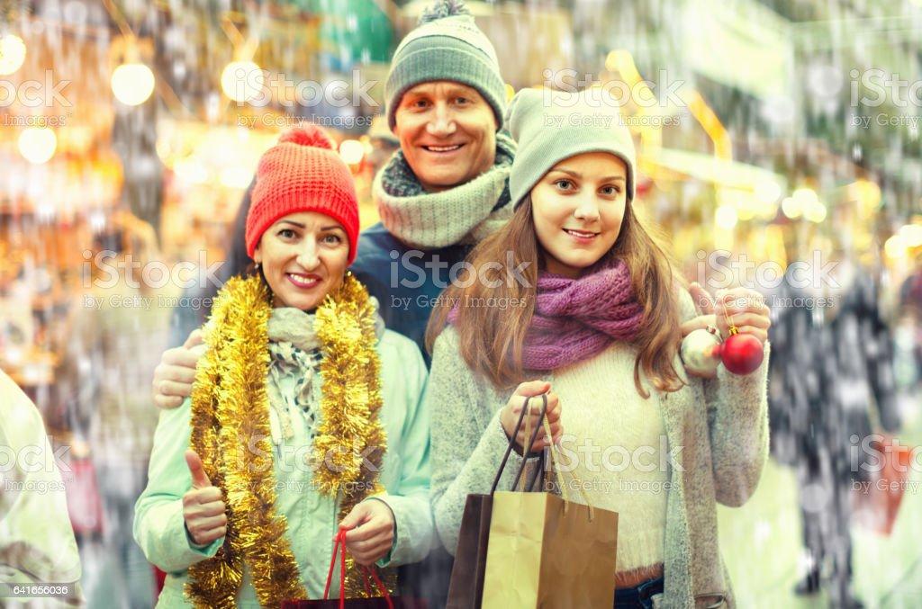 Family of three posing at Christmas market stock photo