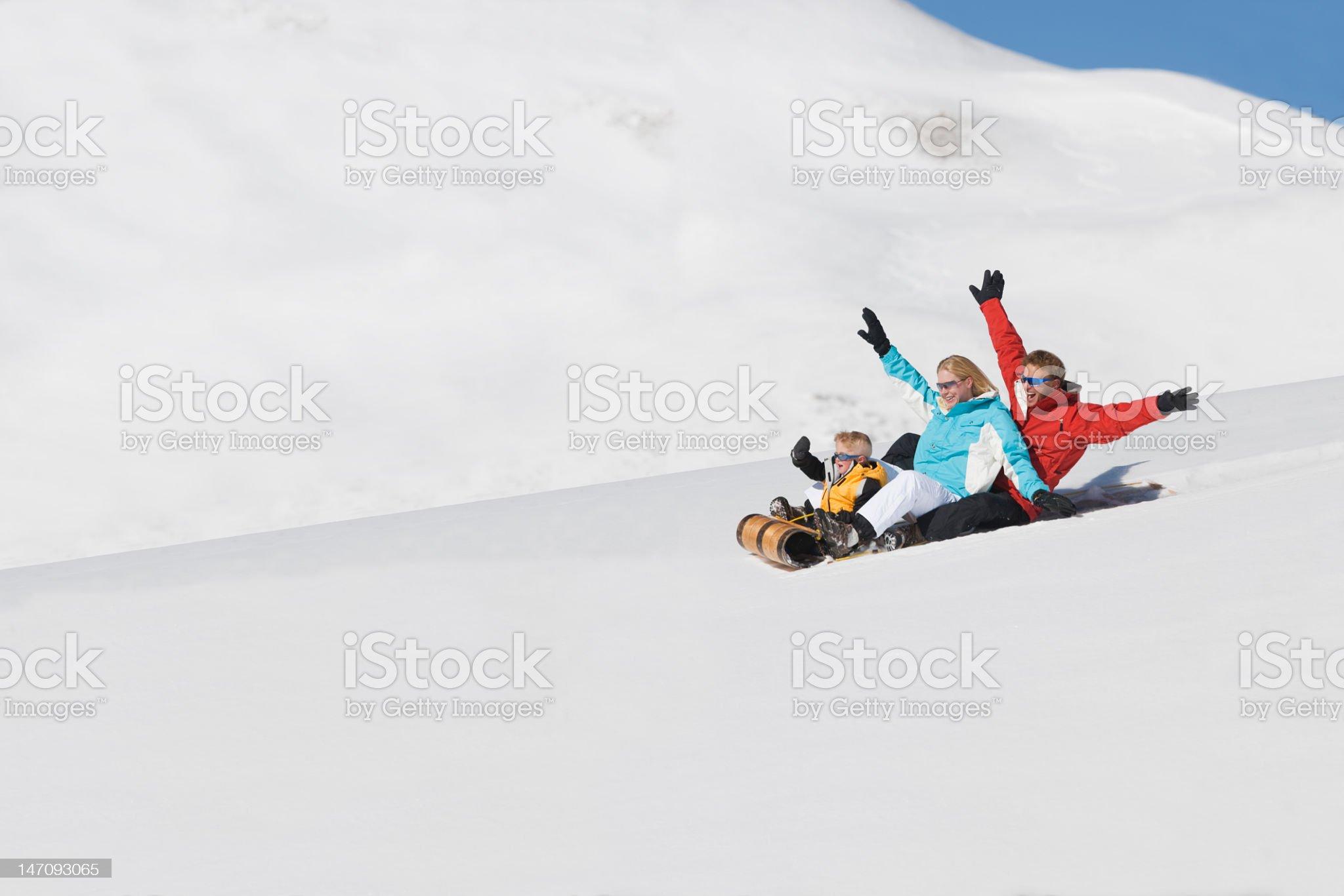Family Of Three Sledding In Colorado royalty-free stock photo