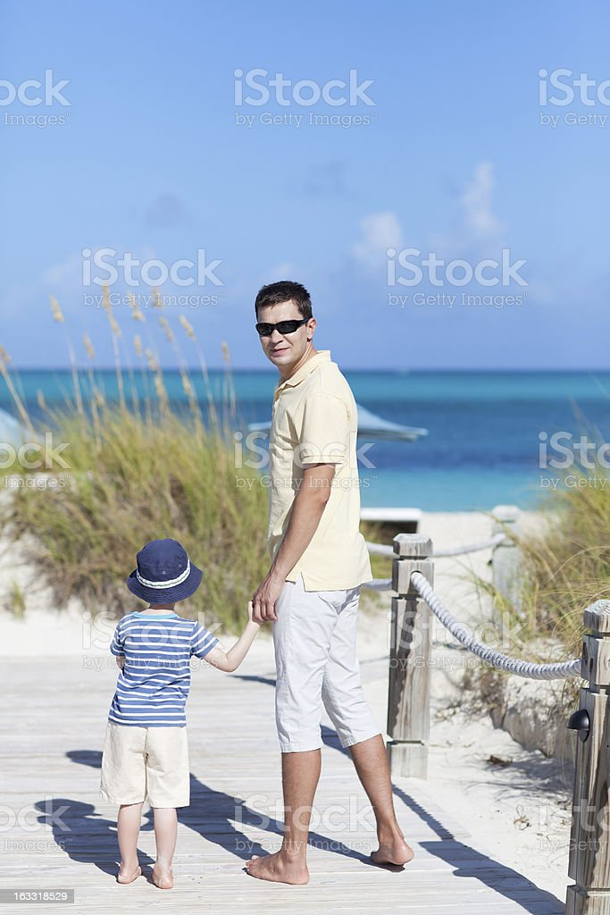 family of two at the beach stock photo