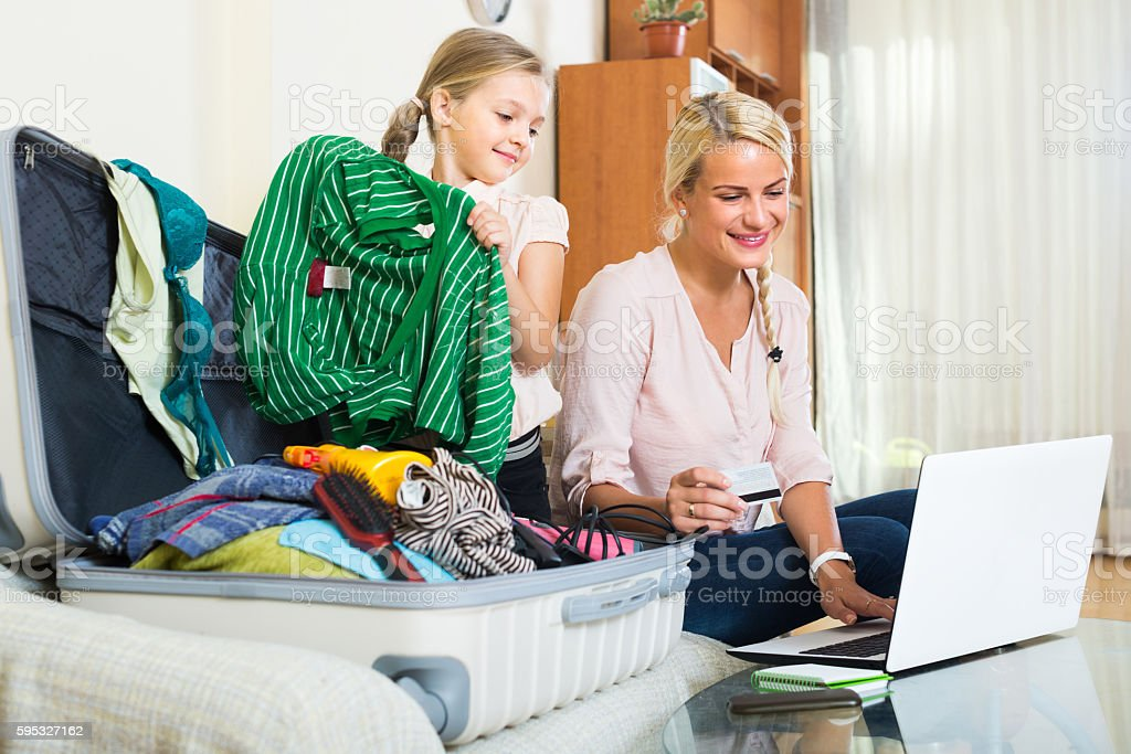 Family of two buying tickets online stock photo