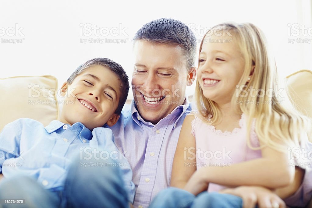 Family of two children having a fun at home royalty-free stock photo