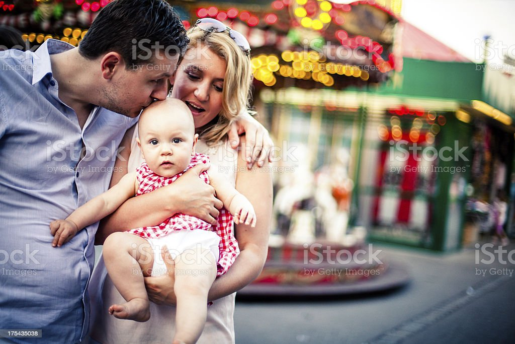 Family on a carousel ride royalty-free stock photo