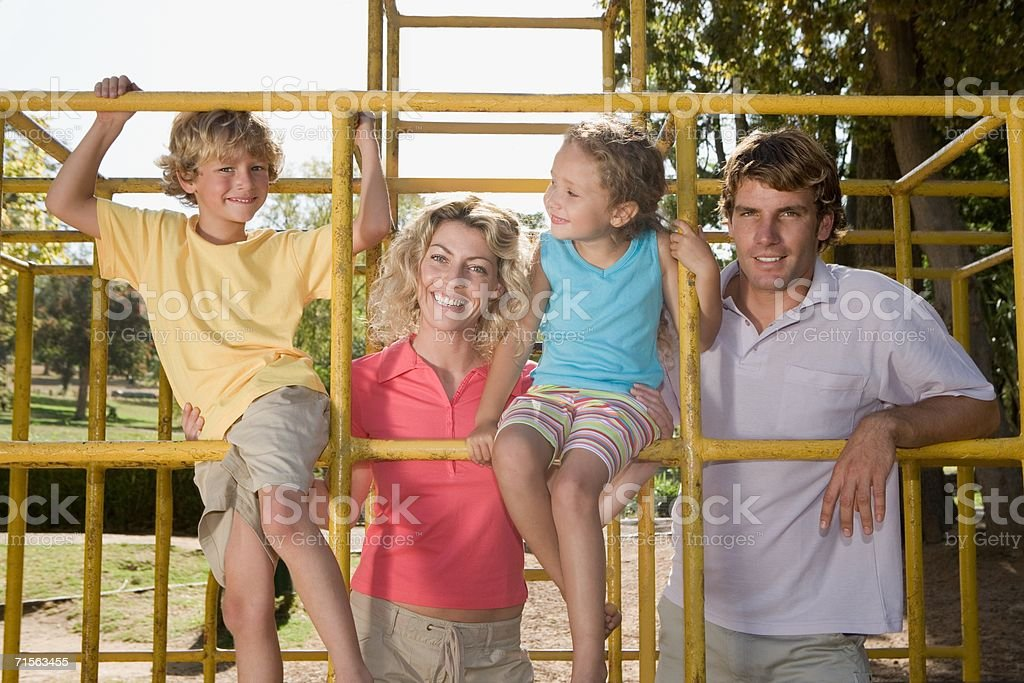 Family on a climbing frame royalty-free stock photo