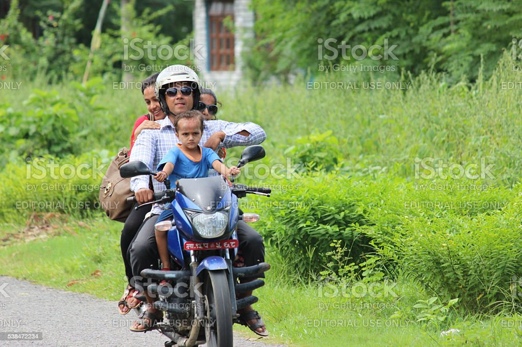 Family on a motor bike stock photo