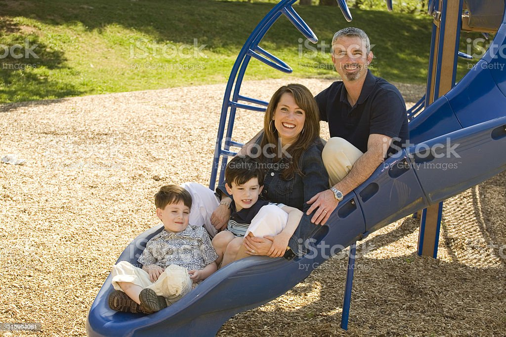 Family on a Slide - Horizontal royalty-free stock photo