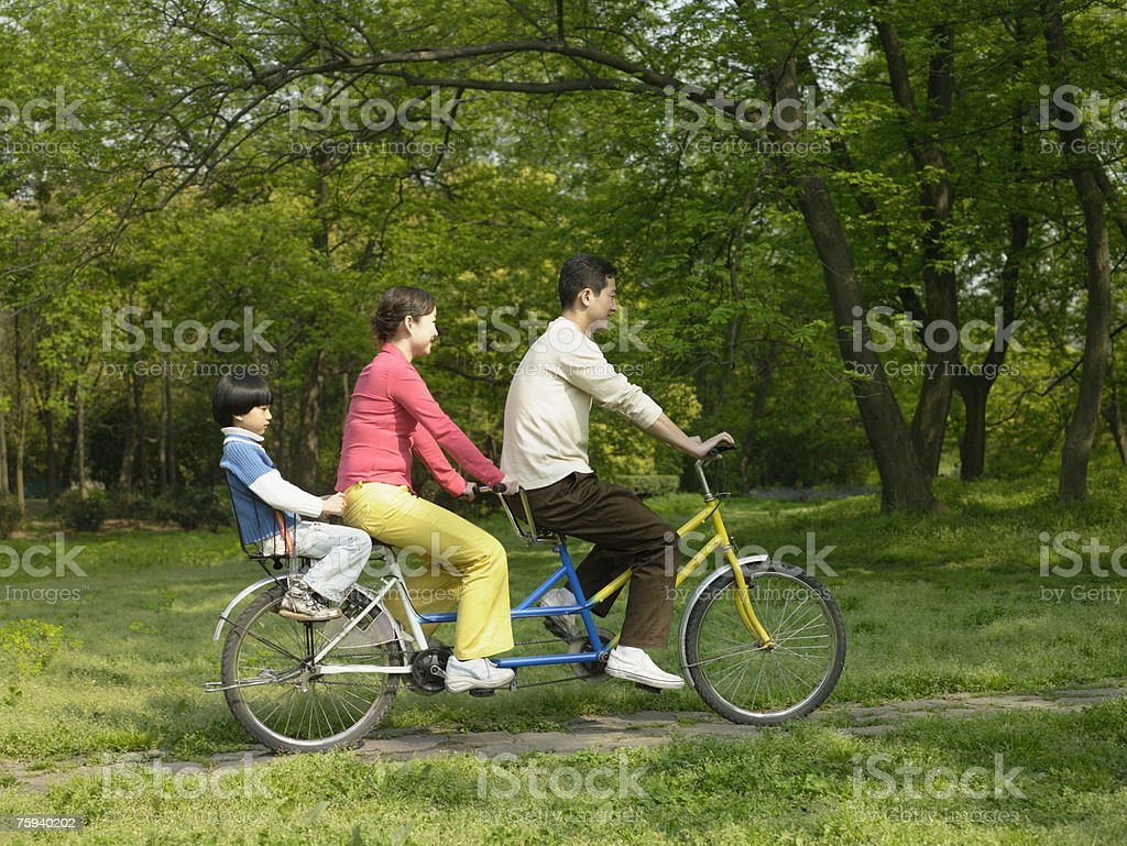 Family on a tandem bike stock photo