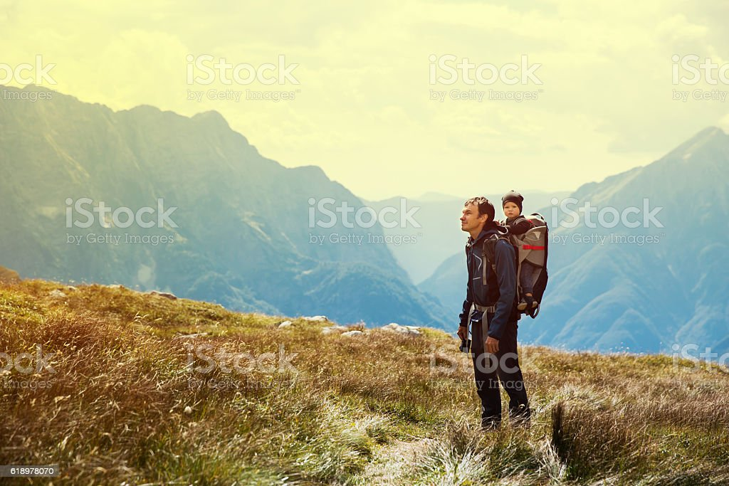 Family on a trekking day in the mountains stock photo