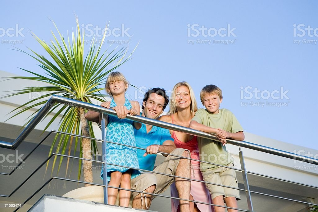 Family on balcony royalty-free stock photo