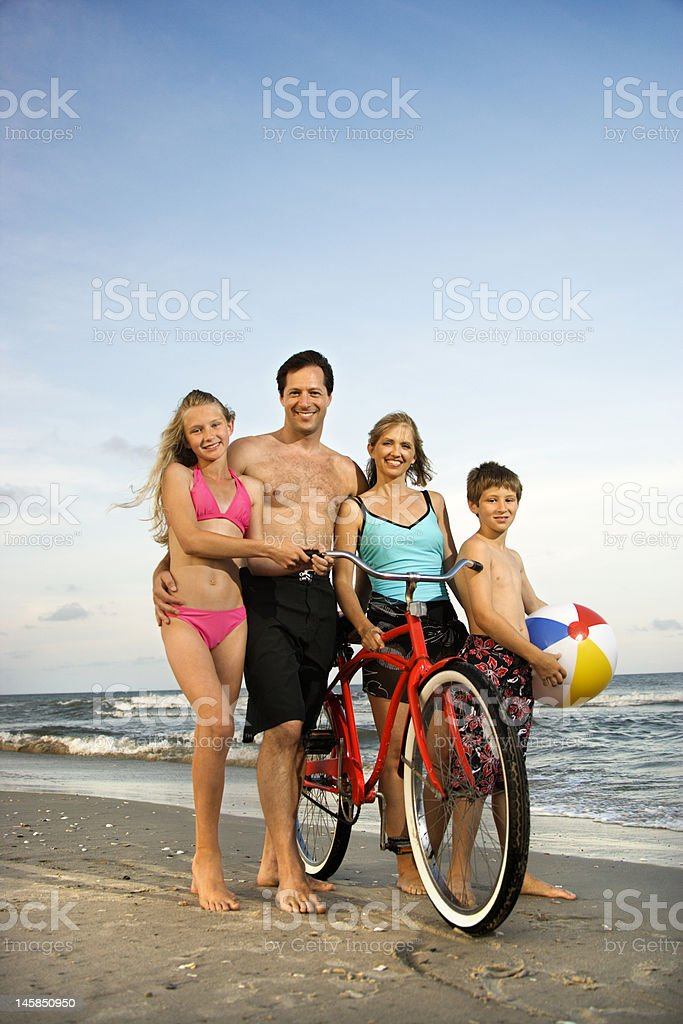 Family on beach. stock photo