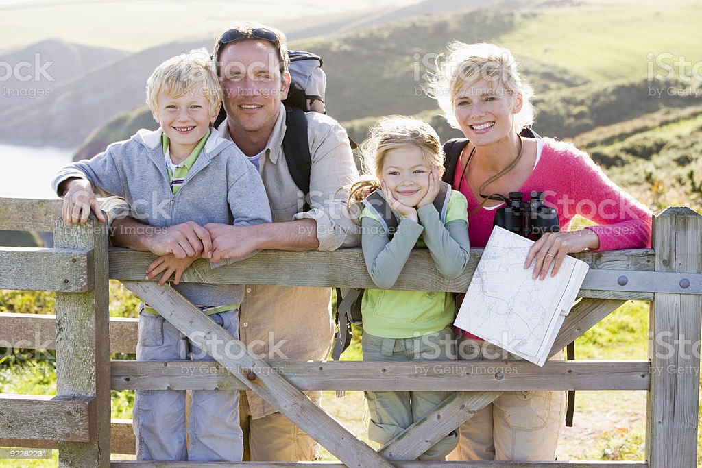 Family on cliffside path royalty-free stock photo