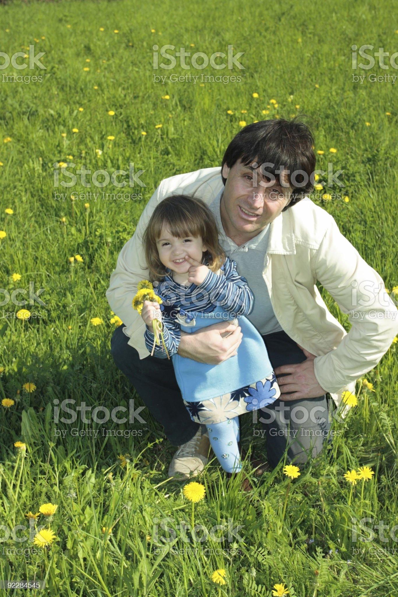 Family on dandelion field royalty-free stock photo