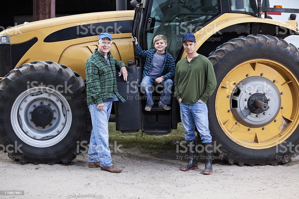 Family on farm tractor stock photo