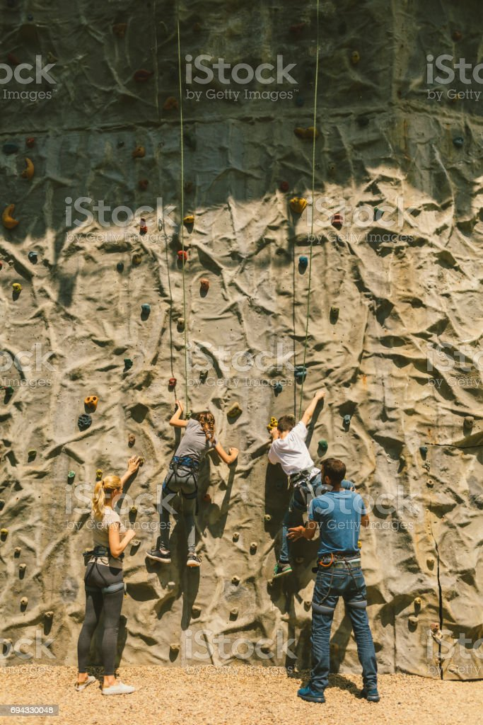 Family on free climbing stock photo