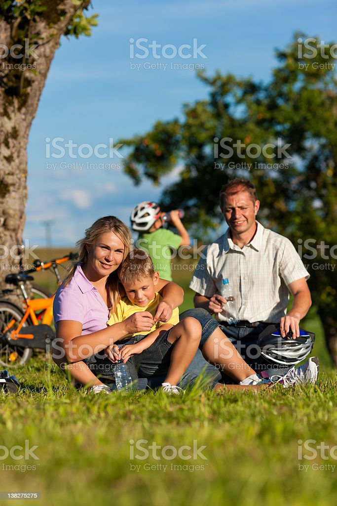 Family on getaway with bikes royalty-free stock photo