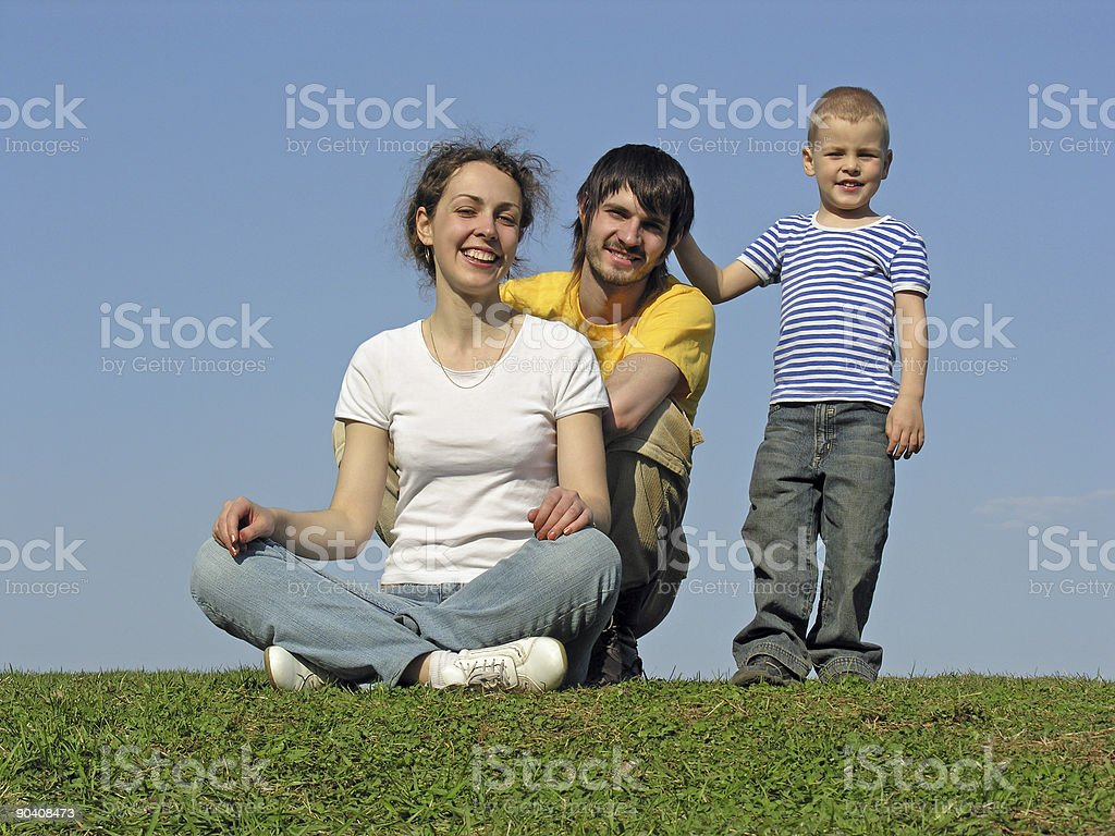 family on grass sit royalty-free stock photo