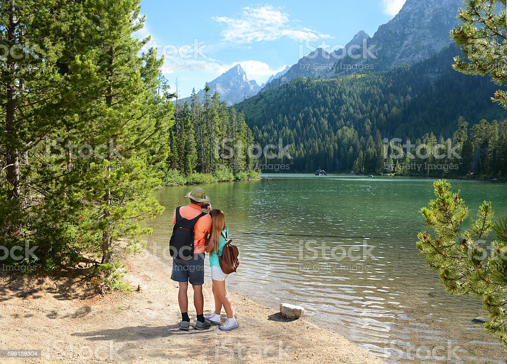 Family on hiking trip in mountains. stock photo